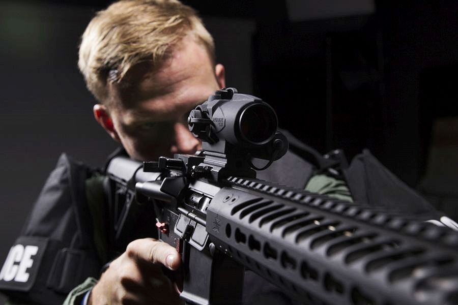 Police officer with a red dot sight mounted to an AR-15